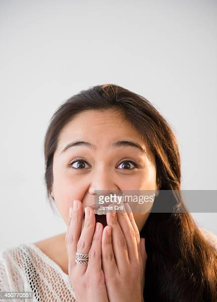 Studio shot of beautiful young woman laughing