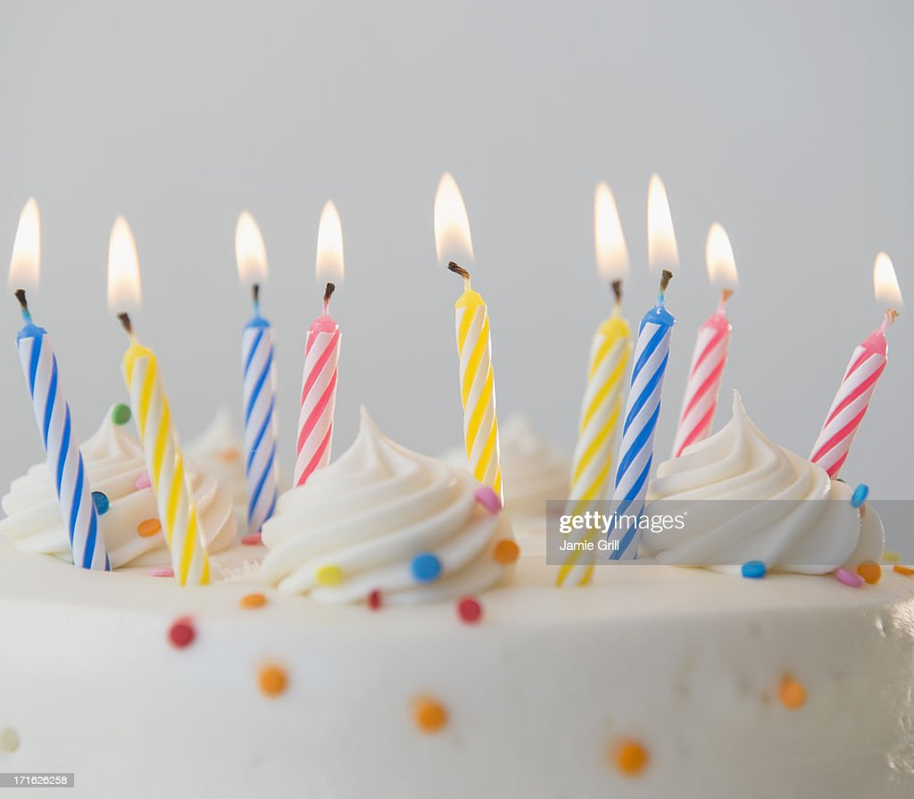 Studio shot of birthday cake with lit candles : Stock Photo