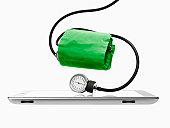 Studio shot of blood pressure gauge on digital tablet