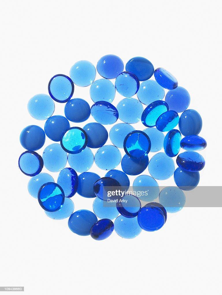 Studio shot of  blue  glass beads in sphere