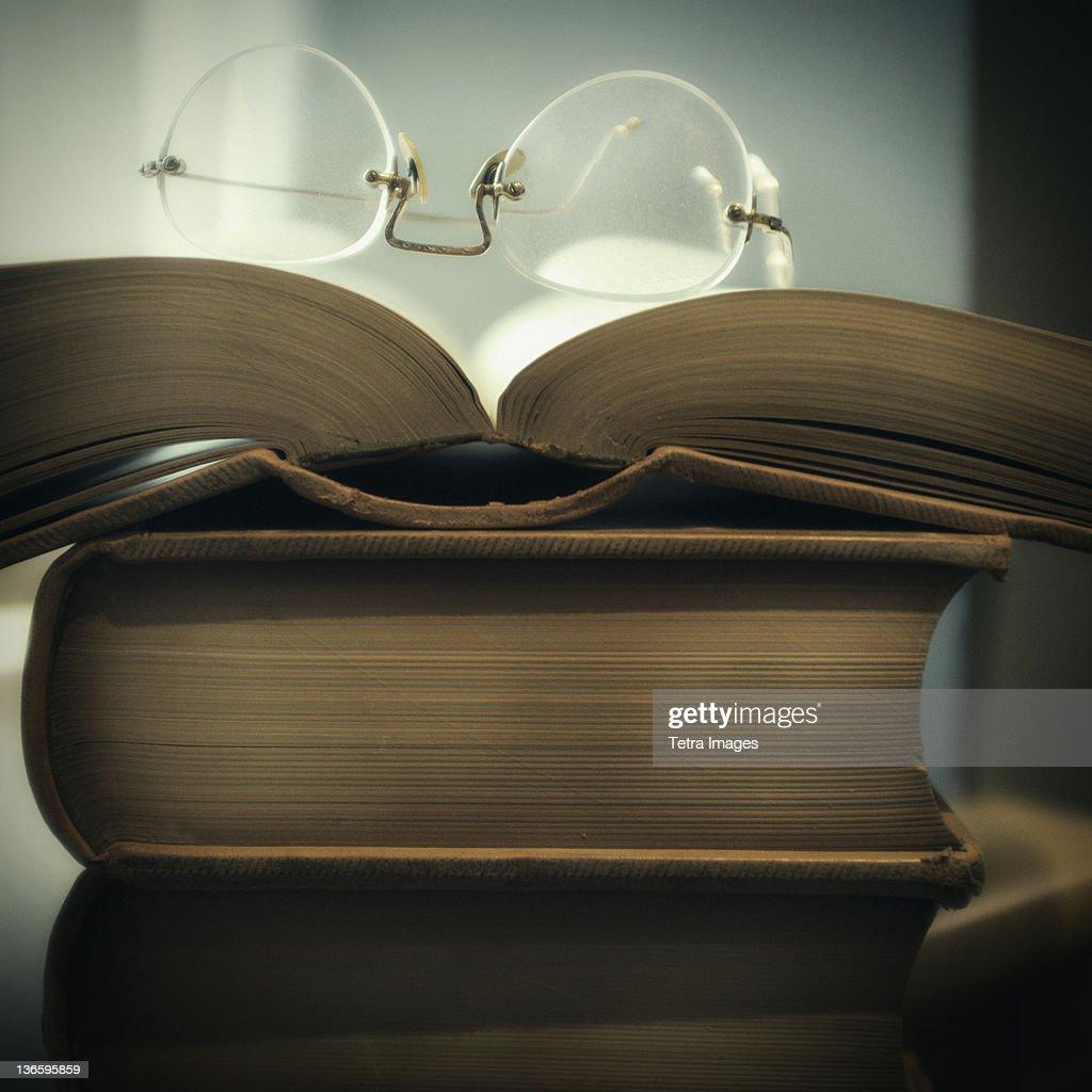 Studio shot of books and eyeglasses