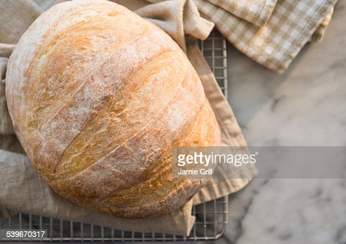 Studio shot of bread on dishcloth