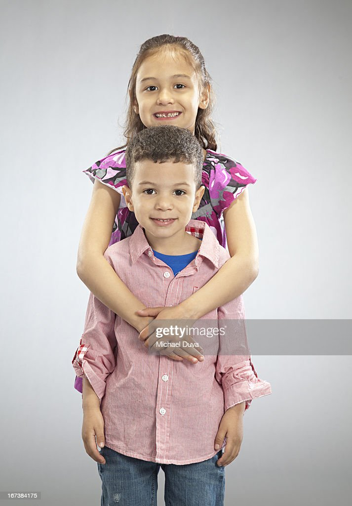 studio shot of brother and sister  gray background : Stock Photo
