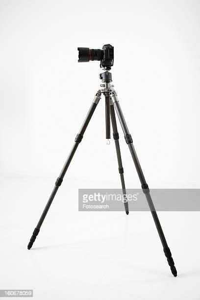 Studio shot of camera and tripod