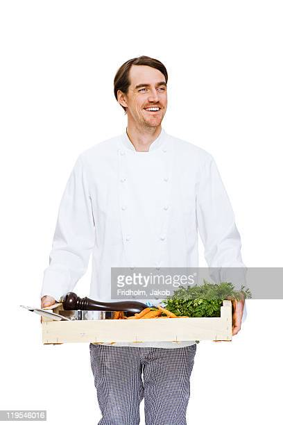 Studio shot of chef holding crate