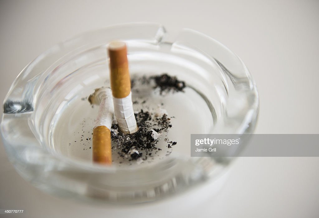 Studio Shot of cigarette butts in ashtrey