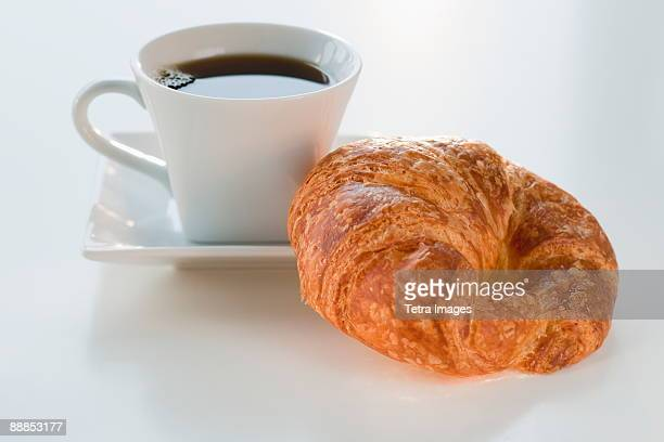 Studio shot of coffee and croissant