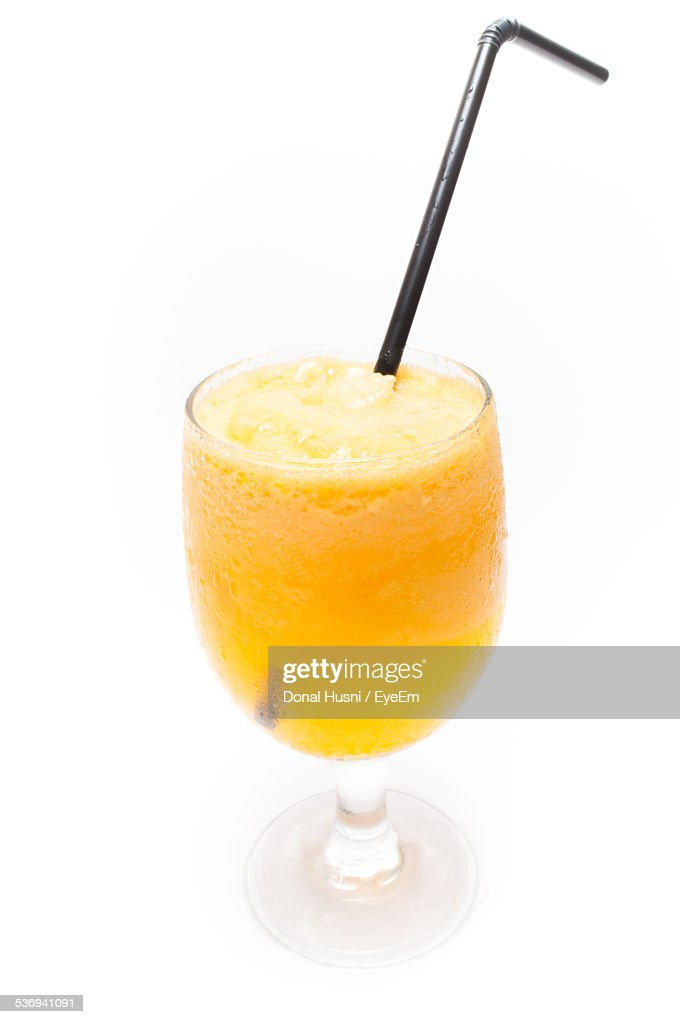 Studio Shot Of Cold Orange Juice On White Background