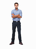 Studio shot of confident business man standing with hands folded