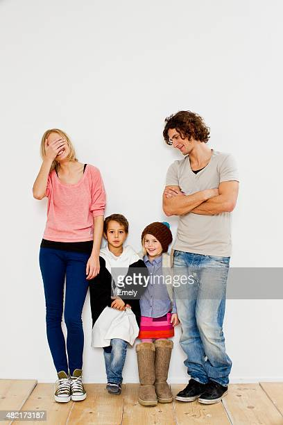 Studio shot of couple with son and daughter in oversize clothes