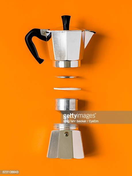 Studio Shot Of Disassembled Italian Coffee Maker On Yellow Background