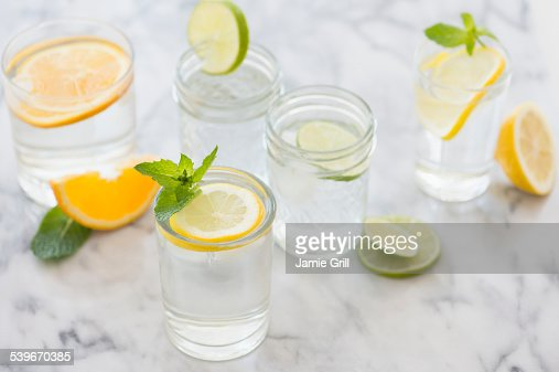 Studio shot of drinks with lemon, lime and orange