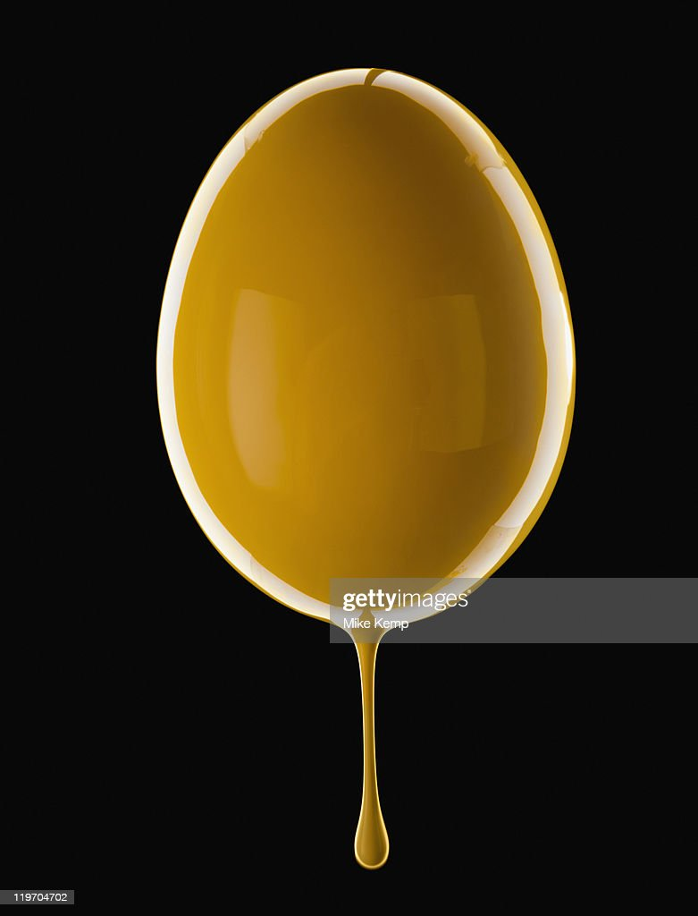 Studio shot of egg covered with yellow paint stock photo for Eggshell yellow paint