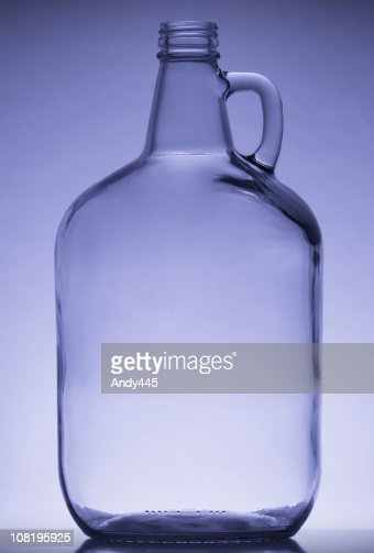 Studio Shot of Empty Glass Jug on Blue Background