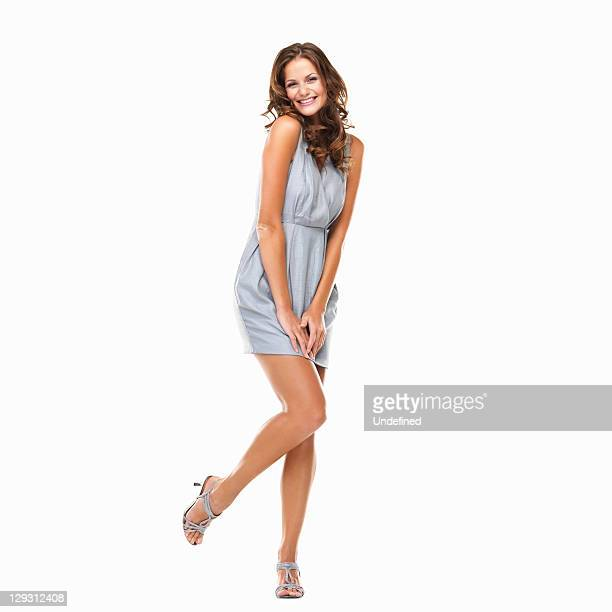 Studio shot of excited young woman in mini dress