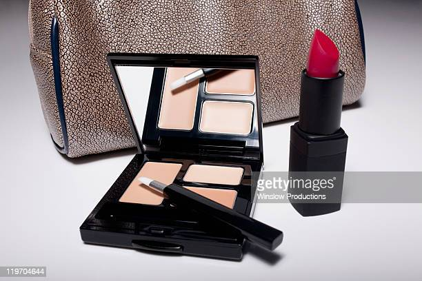 Studio shot of female handbag and make-up kit