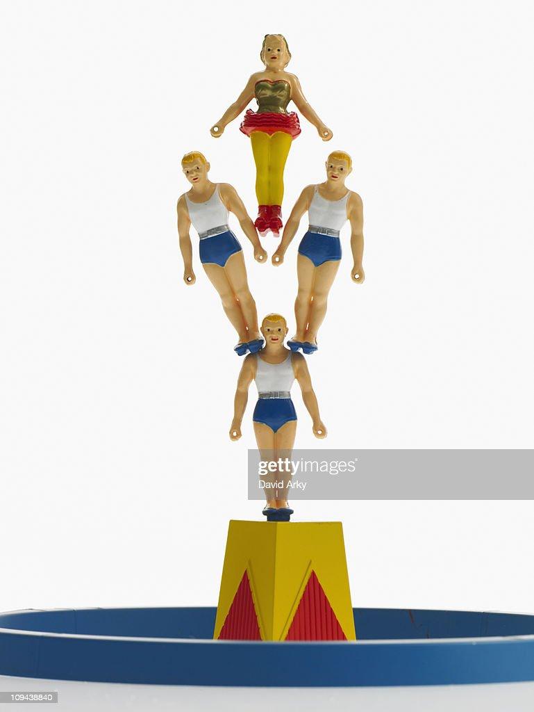 Studio shot of figurines of acrobats