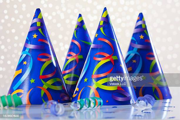 Studio shot of four party hats