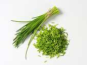Studio shot of fresh chives - bunch and chopped