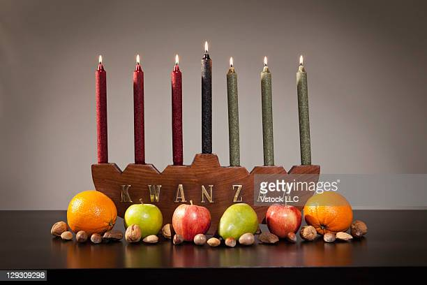 Studio shot of fruits and candles