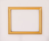 Studio shot of golden picture frame on white background