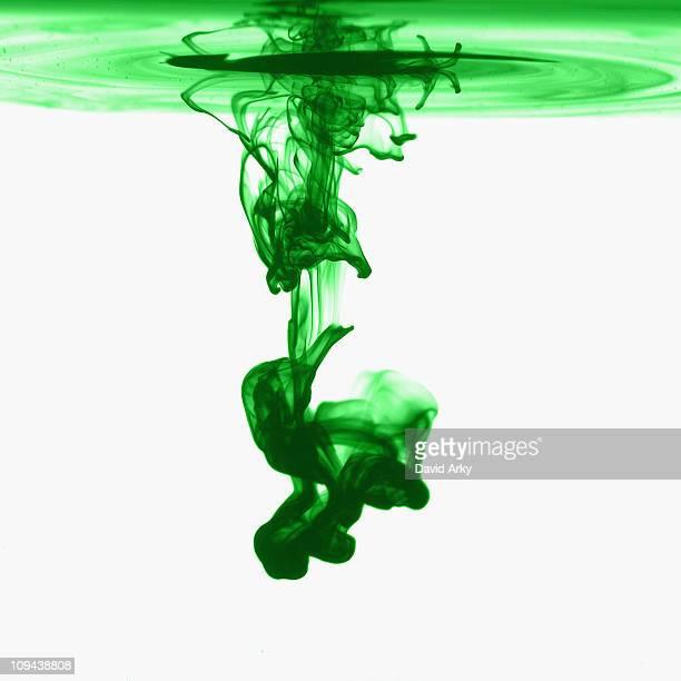 Studio shot of green dye in abstract shape