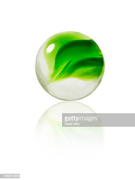 Studio shot of green marbles arranged in Exclamation Point