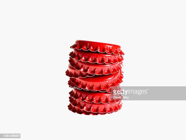 Studio shot of heap of red bottle caps
