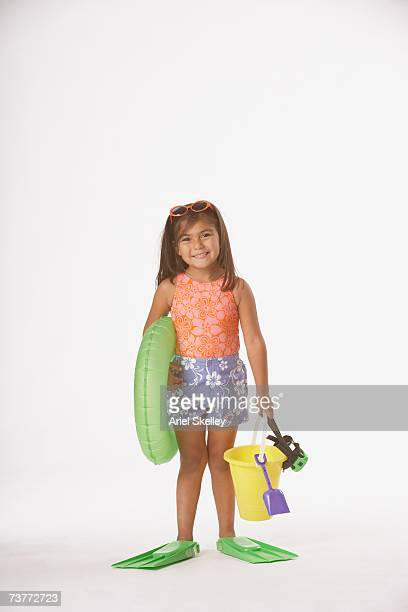 Studio shot of Hispanic girl with beach toys