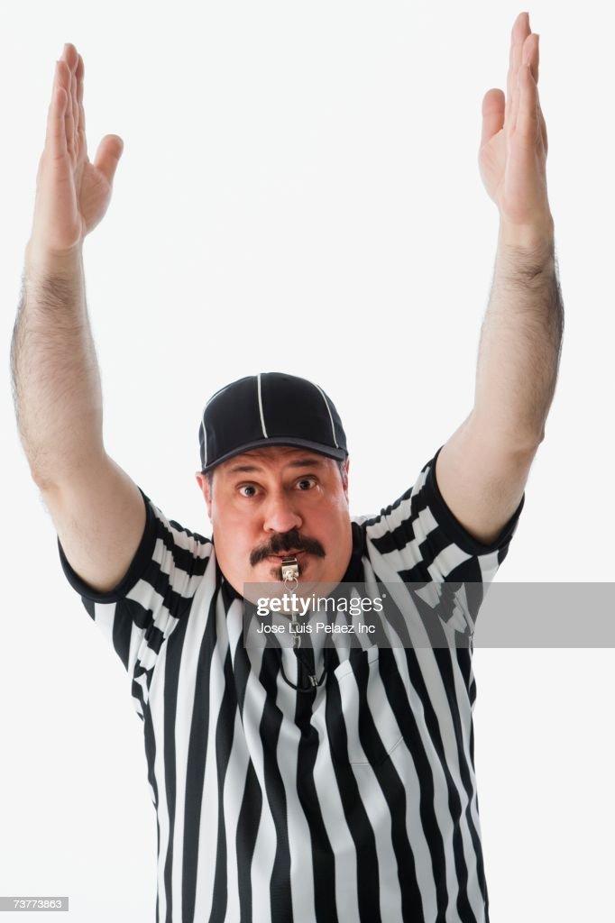 Studio shot of Hispanic male referee making a call : Stock Photo