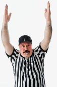 Studio shot of Hispanic male referee making a call