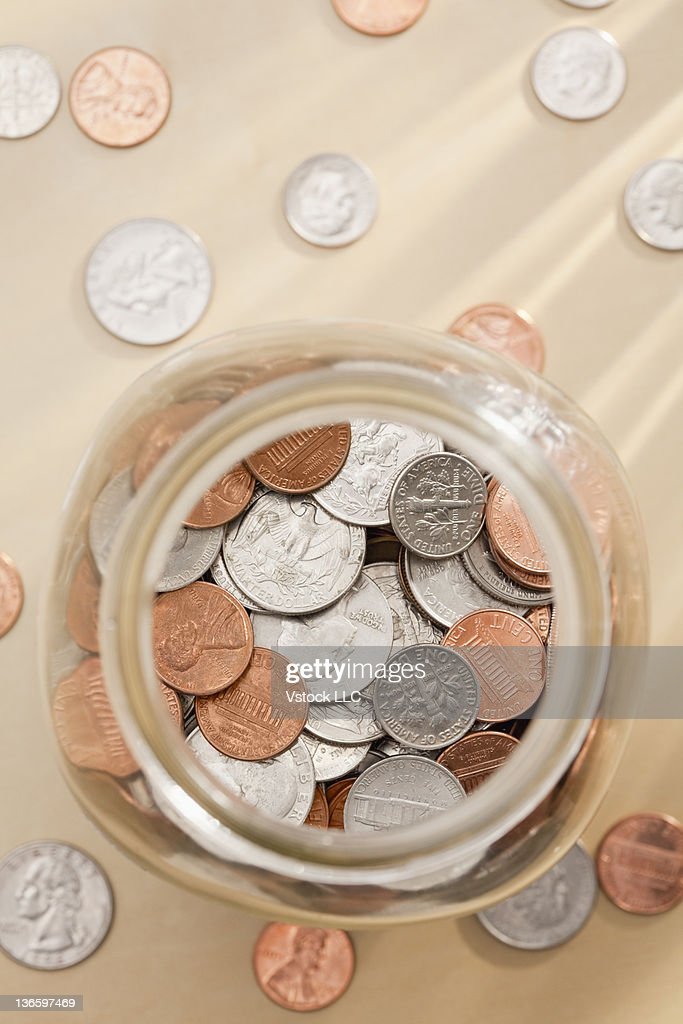 Studio shot of jar with coins : Stock Photo