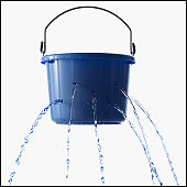 Studio shot of leaking bucket