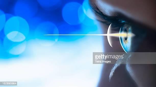 Studio shot of light beam coming from eye