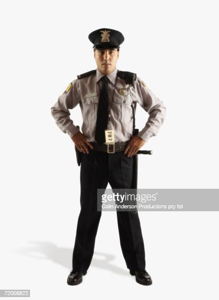 Studio shot of male police officer