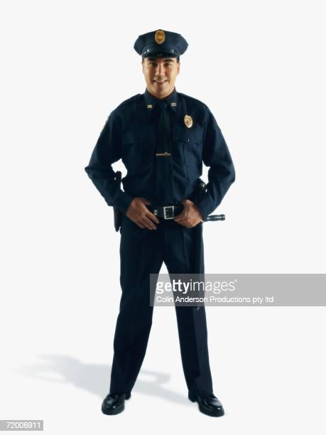 Studio shot of male police officer smiling