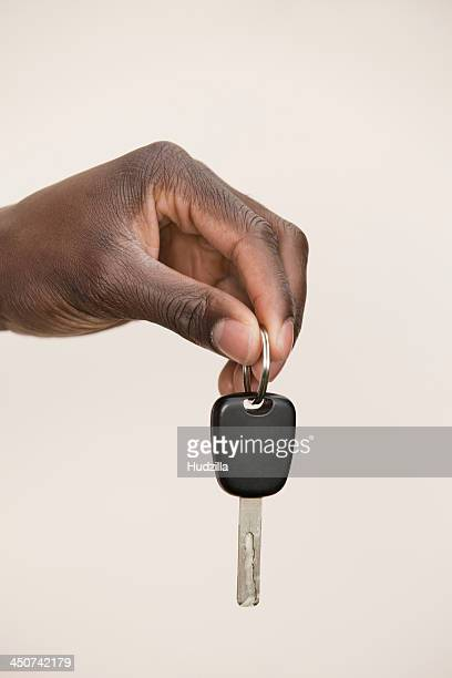 Studio shot of man holding car key