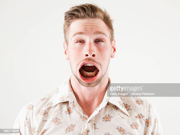 Studio shot of man with windblown mouth