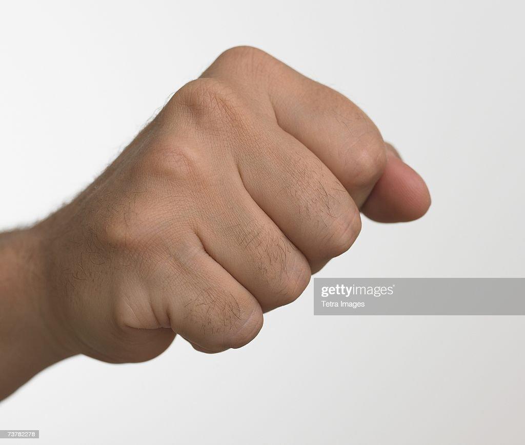 Studio shot of man's hand making fist