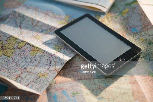 Studio Shot of maps and digital tablet