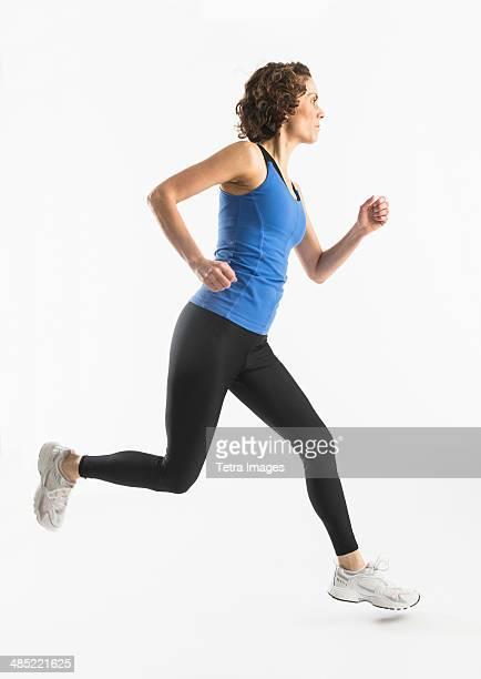 Studio shot of mature woman jogging
