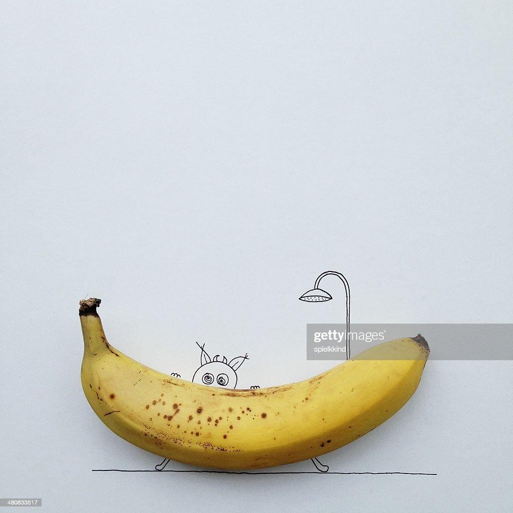 Studio shot of monster eating banana : Stock Photo