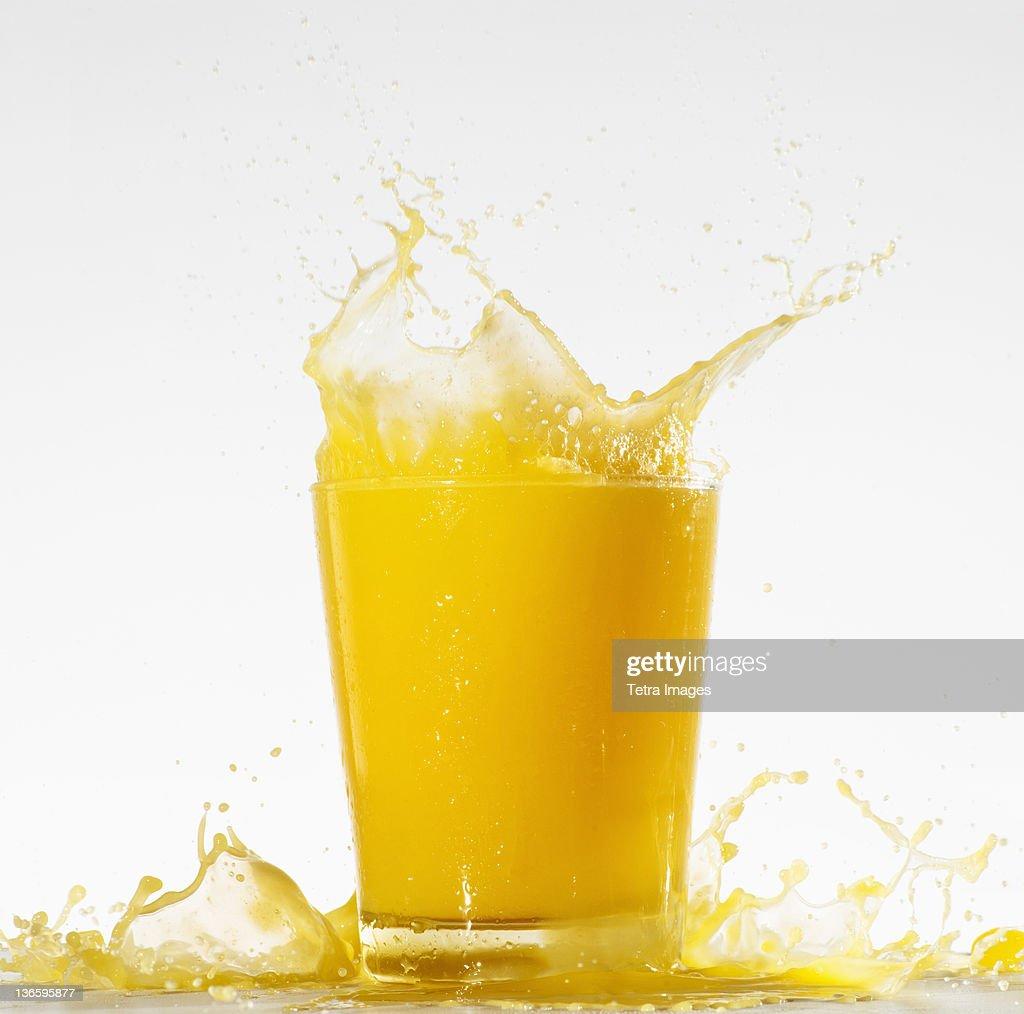 Studio shot of orange juice with splash