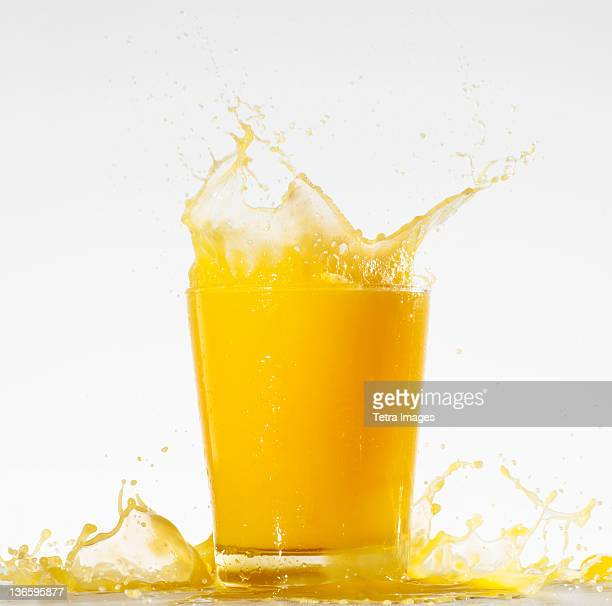 Studio shot of orange juice with splash