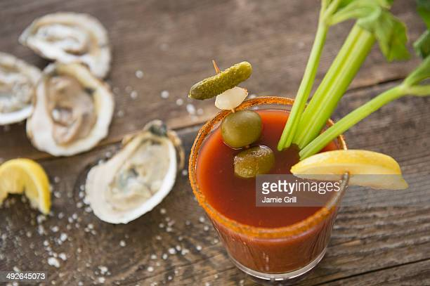 Studio shot of oysters and bloody mary