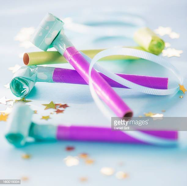 Studio shot of party blowers and confetti