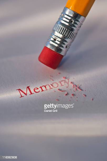 Studio shot of pencil erasing the word memory from piece of paper