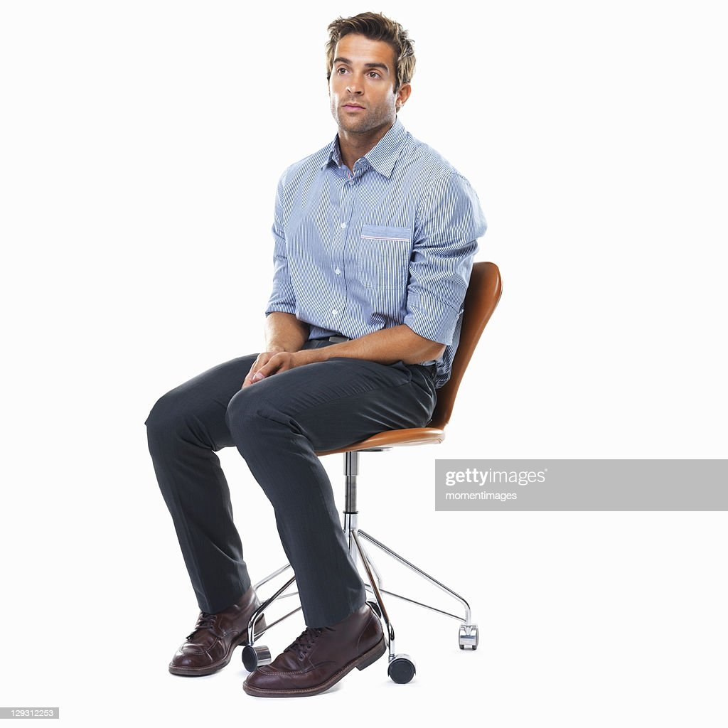 Man sitting in chair side - Studio Shot Of Pensive Business Man Sitting On Chair Stock Photo