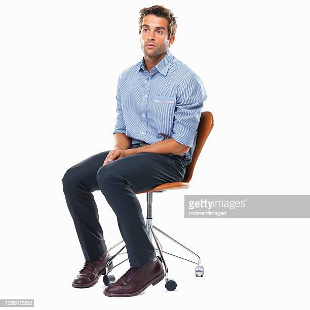 Studio shot of pensive business man sitting on chair
