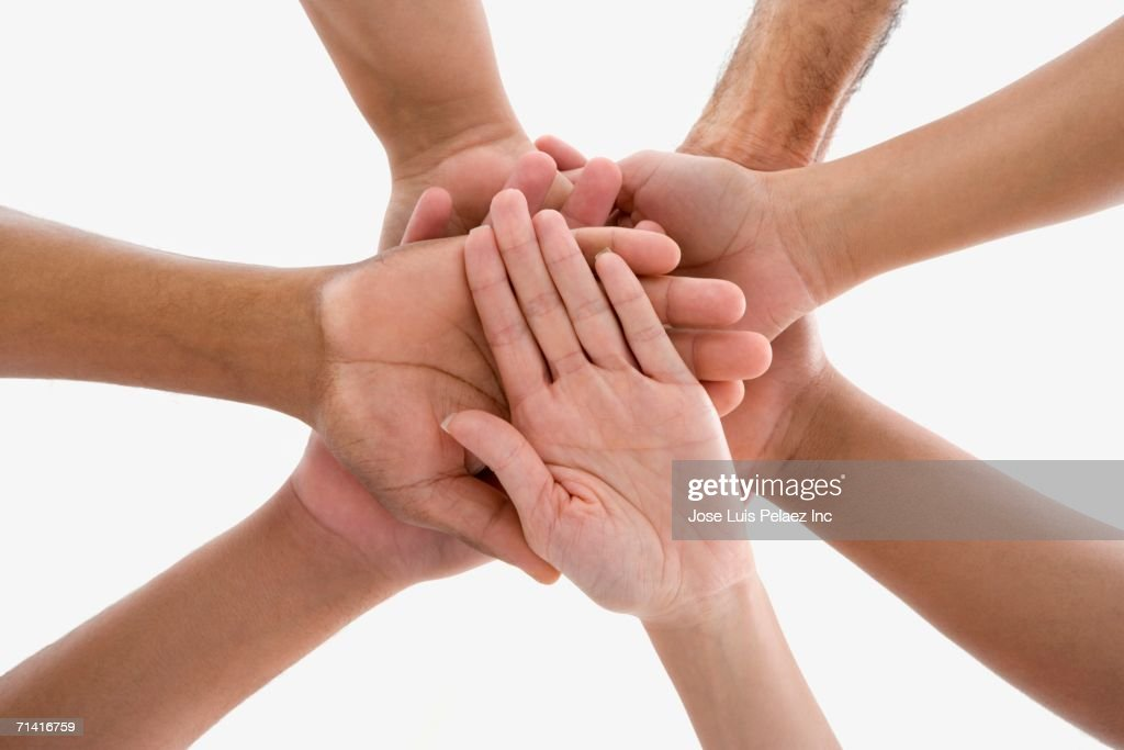 Studio shot of people's hands in the center of a huddle : Stock Photo